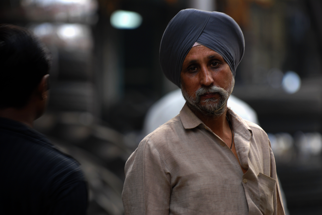 The photograph of a sikh is taken by Kristian Bertel in an alley in Delhi, India.