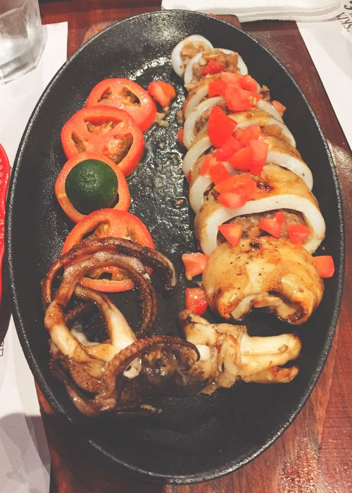 Sizzling sisig-stuffed squid at Zubuchon