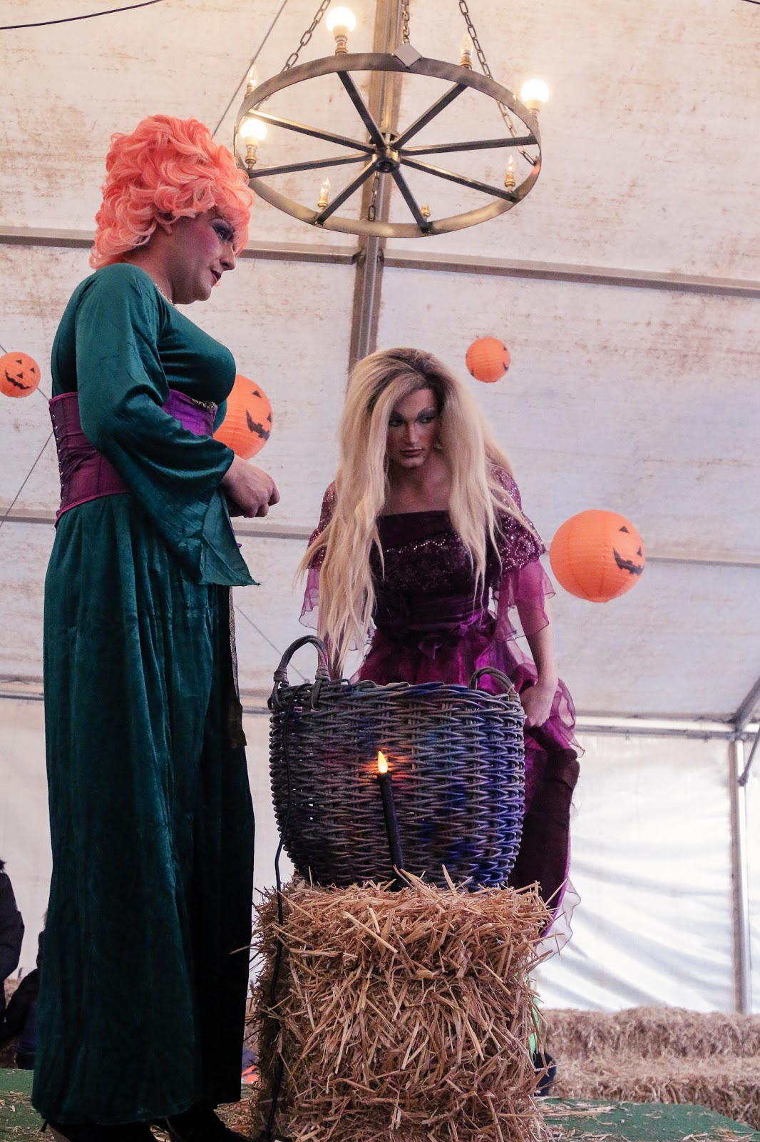 Mid shot of the three witches at the M&D's pumpkin festival - Three drag queens dressed up as the three hocus pocus witches.