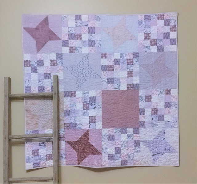 Friendship star quilt with quilt blocks that were bleached and dyed