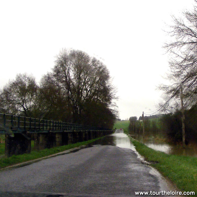 Road cut by flood waters, February 2021, Perusson, Indre et Loire, France. Photo by Loire Valley Time Travel.