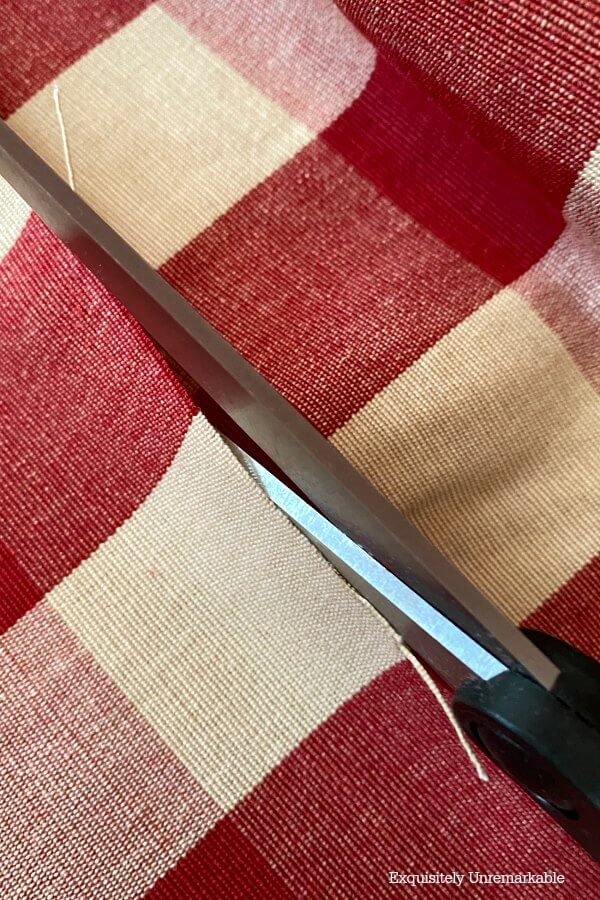 Cutting Red Checked Fabric