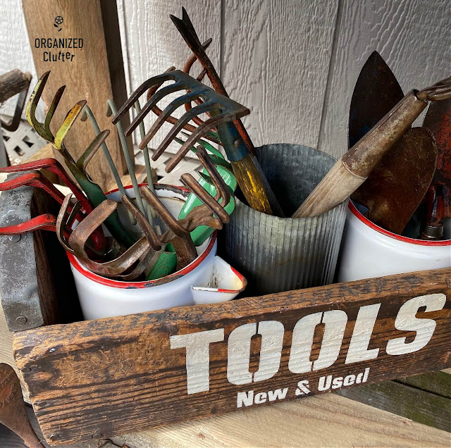 Photo of vintage garden tools in a toolbox