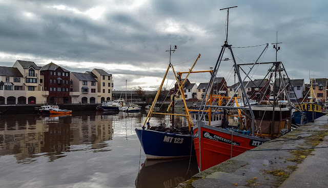 A photo of fishing boats in Maryport Harbour
