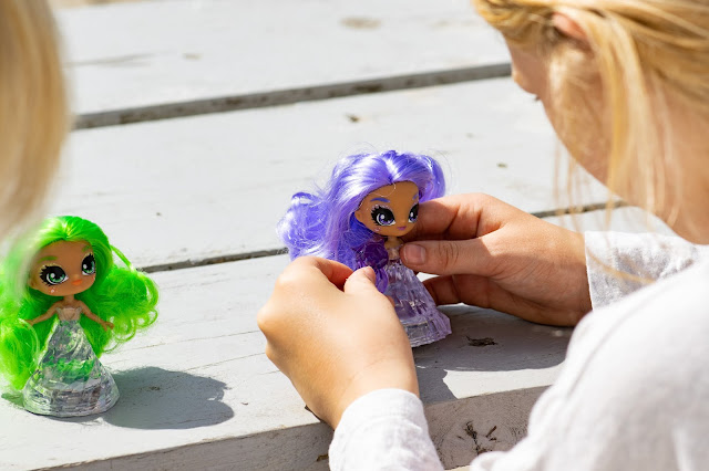 Sisters playing with Crystalina doll