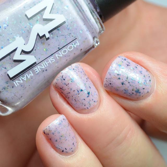 purple nail polish with flakies swatch