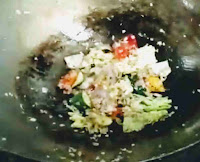 Sauteeing ginger garlic onion bell peppers and Chinese cabbage for ginger honey paneer recipe