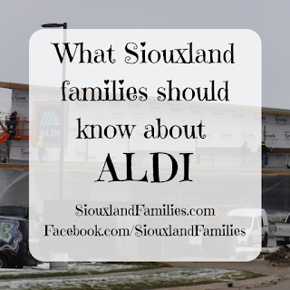 "in background, the new Sioux City Aldi store under construction in early December 2020. In foreground, the words ""What Siouxland Families should know about ALDI"""