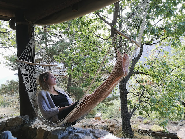 Woman relaxing in a hammock in nature