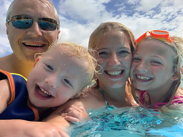 A family selfie in the swimming pool (parents and 2 children)