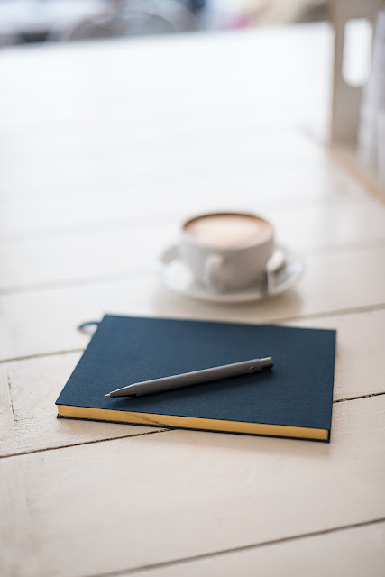 Selective Focus Photography of Black Pen on Book | Photo by @Bookblock via Unsplash