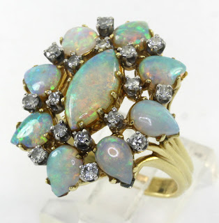 http://www.ebay.com/itm/Diamond-opal-estate-ring-18K-yellow-gold-round-brilliant-pear-marquise-4-85C-sz9-/371674362558?hash=item568984b2be