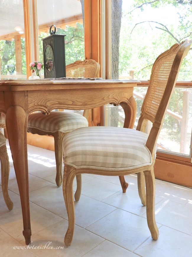 French Country cane back dining chair with curved wood legs