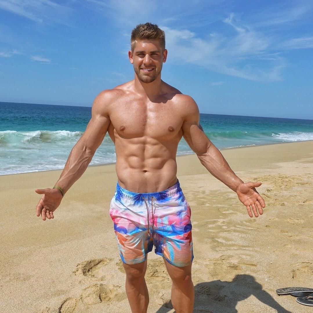 fit-shirtless-muscular-young-beach-hunk-smiling-strong-veiny-arms