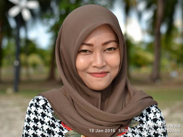 Matt Hahnewald Photography; Facing the World; closeup; street portrait; headshot; outdoor; Asia; Southeast Asia; Malaysia; Langkawi; Kuah; smiling; beautiful; Malay woman; posing; beach; makeup; stylish; 1Malaysia; travel; travel destination; Muslima; Islam; eye contact; brown hijab; closed-mouth smile
