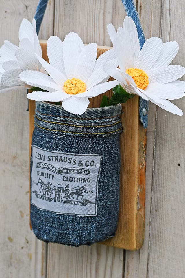 Learn how to repurpose old denim jeans into a hanging mason jar vase. Tutorial by Pillar Box Blue.