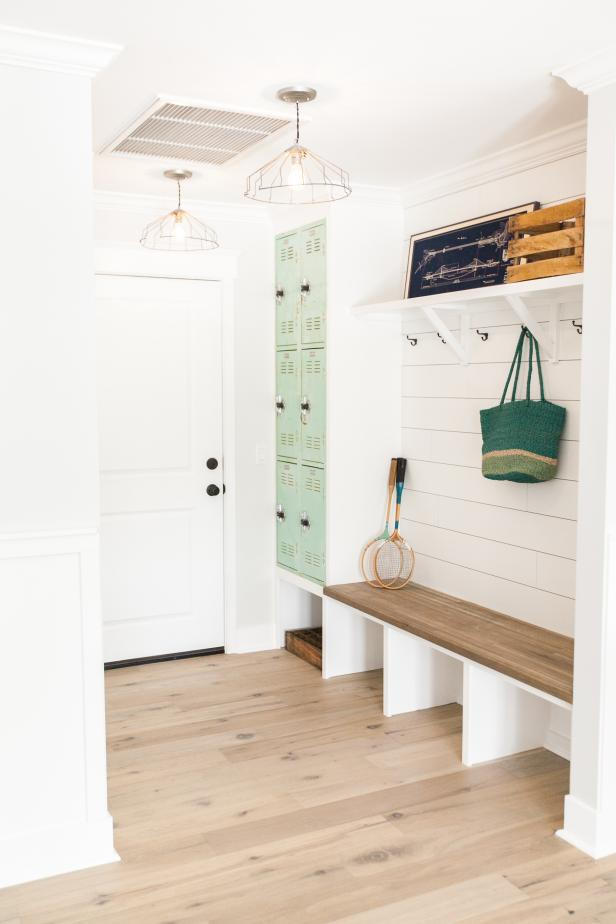 Bright white mudroom with green lockers