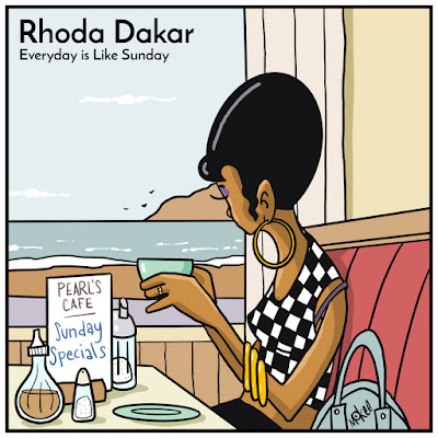 The cover features an illustrated version of Rhoda Dakar sitting in a booth at Pearl's Cafe, holding a cup of tea, and staring out the window at the ocean.
