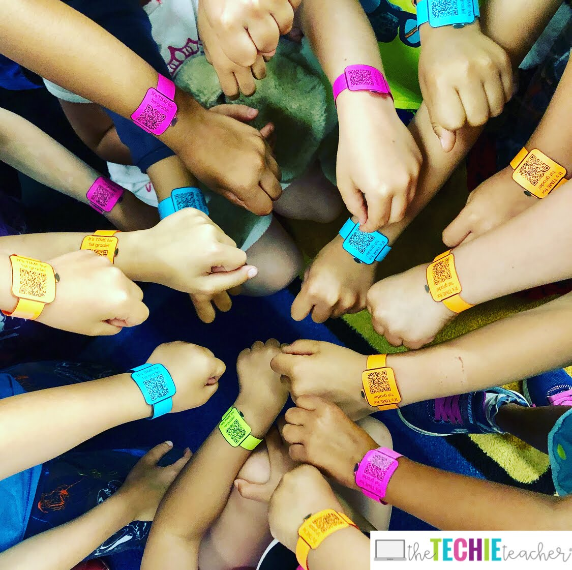 Smartwatches with QR codes that lead to a class slideshow