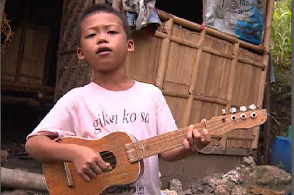 Young boy sings carol to support nine month old sister