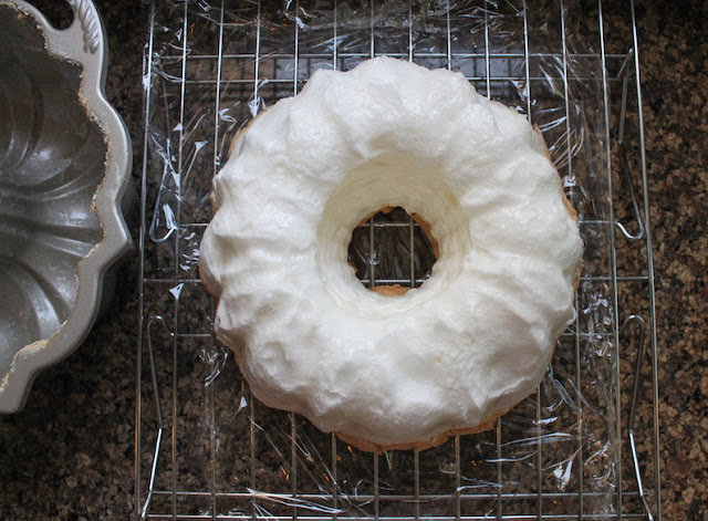 Food Lust People Love: A fun and easy twist on the original French dessert called îles flottantes, this floating island Bundt features meringue baked in a Bundt pan, served with fresh fruit and crème anglais, a pourable vanilla custard.