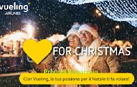 Logo Vueling Airlines #LOVEFORCHRISTMAS  : vinci gratis 5 voli A/R per 2 persone