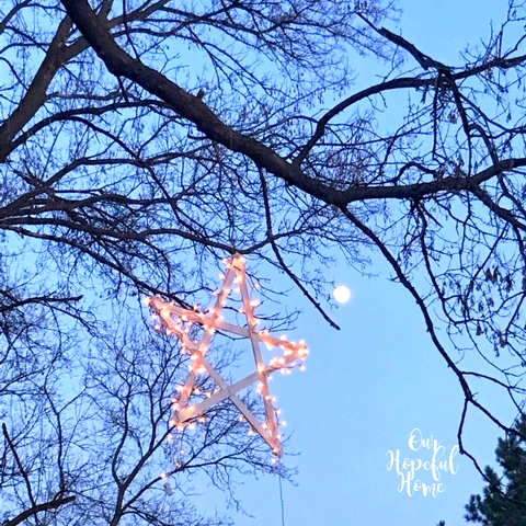 outdoor lighted hanging Christmas star tree sky moon