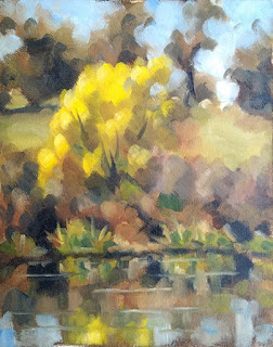 Landscape oil painting of a tree with yellow foliage beside water.