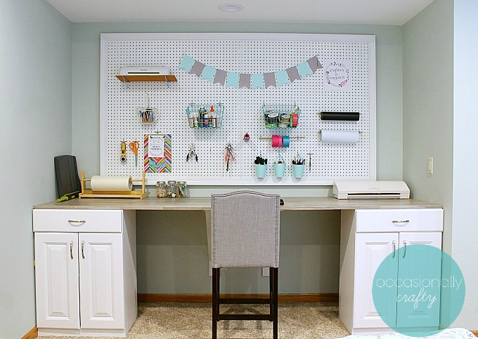 Make your own custom craft table desk from stock cabinets, plywood, and peel & stick vinyl tiles!