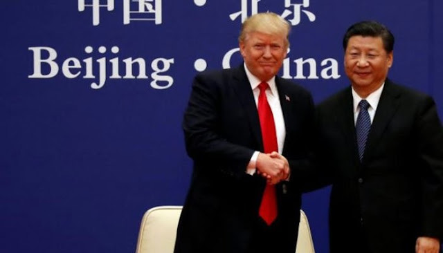 US President Donald Trump and China's President Xi Jinping meet business leaders at the Great Hall of the People in Beijing, China, November 9, 2017. Photo: Reuters