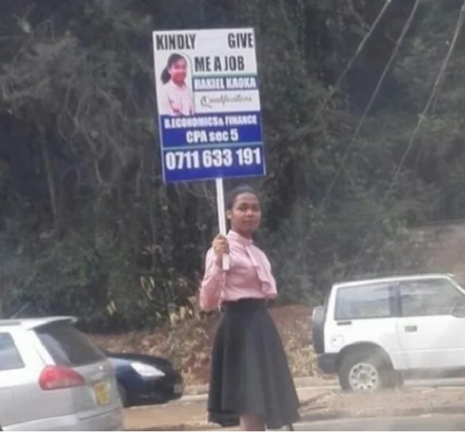 Kenyan lady stands on the road to plead for a job