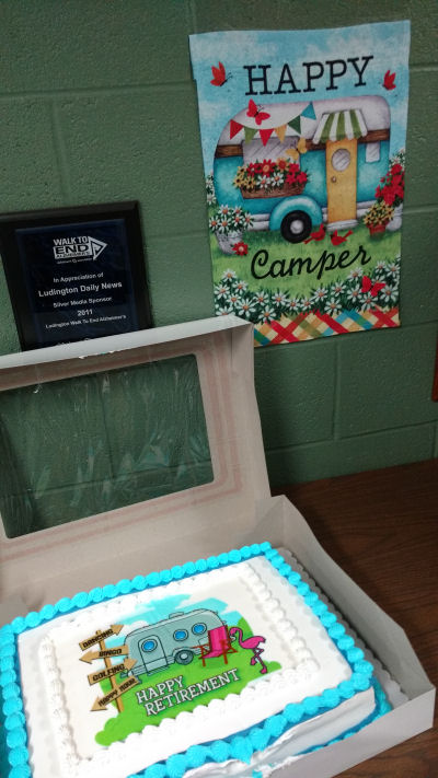 camping trailer cake and banner