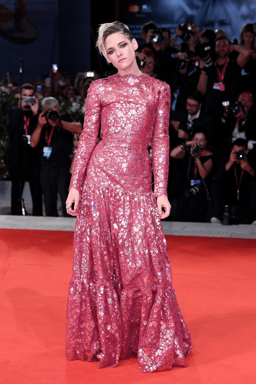 Kristen Stewart cuts a feminine figure in a red laser-cut gown as she leads the arrivals for Seberg premiere at the 76th Venice Film Festival