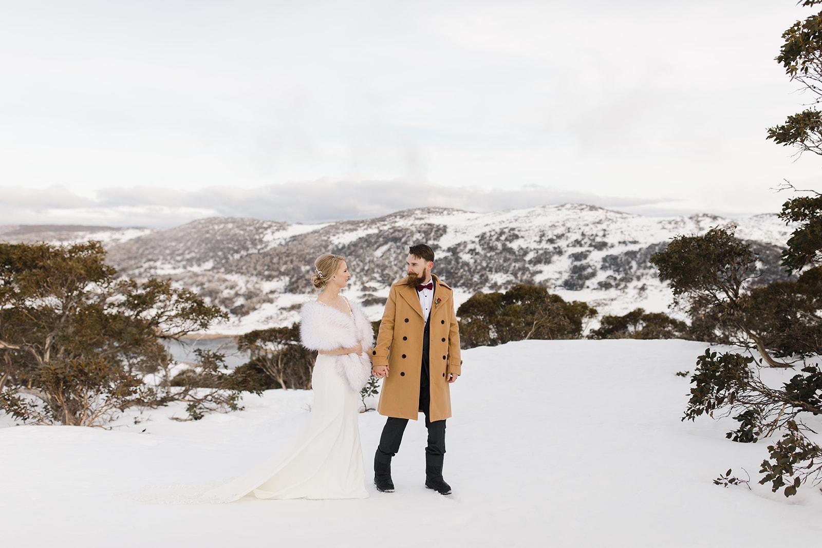zelda green photographer winter snow mountain weddings bridal gowns cake