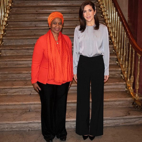 Crown Princess Mary wore Hugo Boss Banora Silk blend blouse.United Nations Under-Secretary-General and Executive Director of UN Women