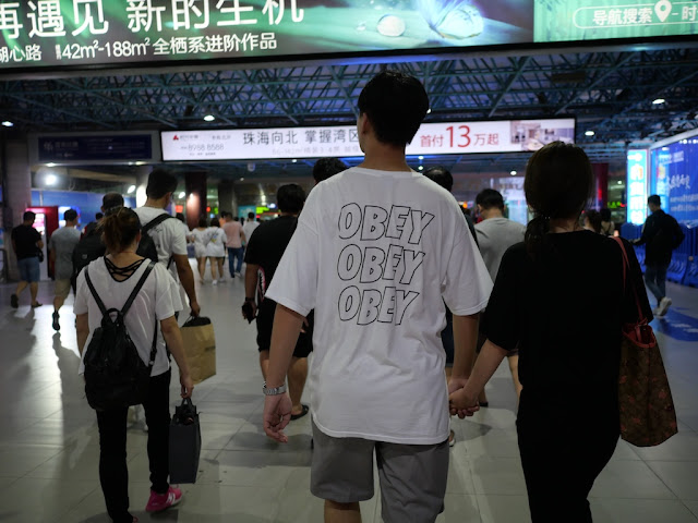 "young man wearing an ""Obey Obey Obey"" shirt"