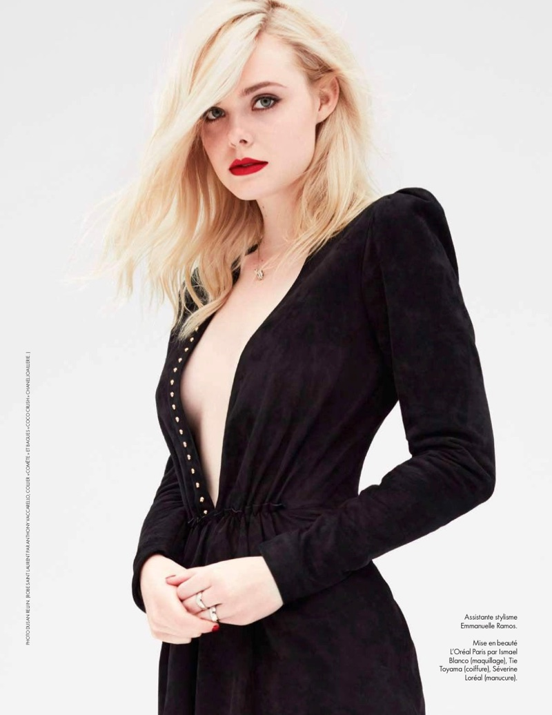Elle Fanning poses in Saint Laurent dress with Chanel jewelry