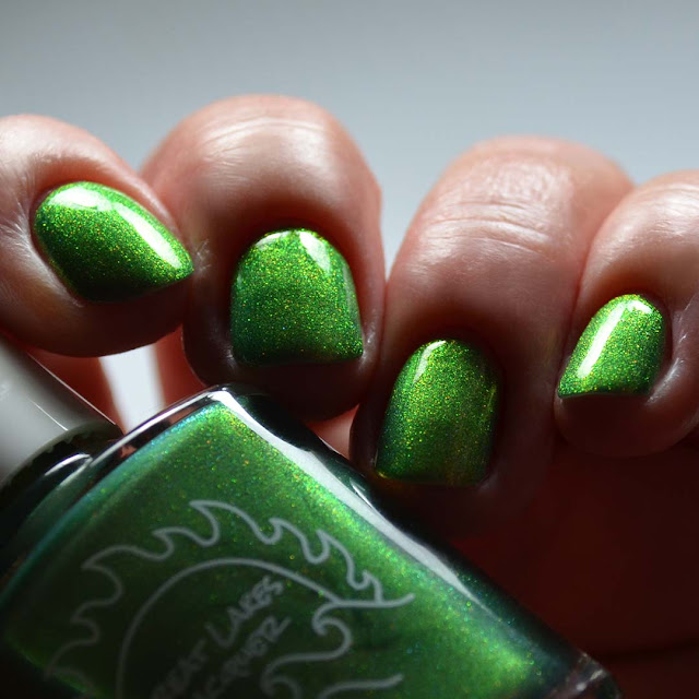 green shimmer nail polish swatch low light