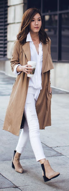 woman in white top and jeans and a tan trench coat