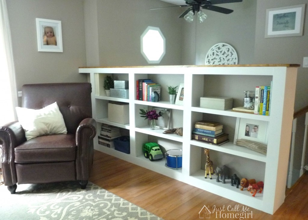 DIY half wall bookcase by stairs