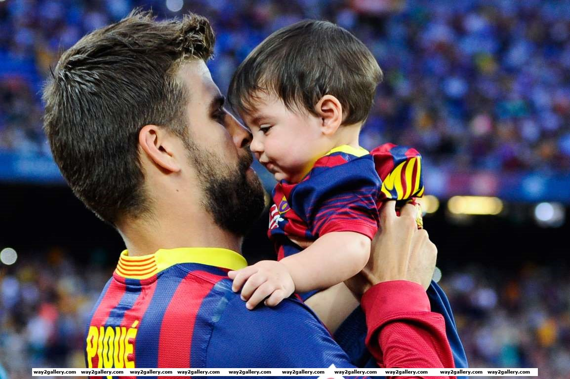 Gerard Pique of FC Barcelona jokes with his son Milan prior to the La Liga match between FC Barcelona and Sevilla FC at Camp Nou on September   in Barcelona Spain