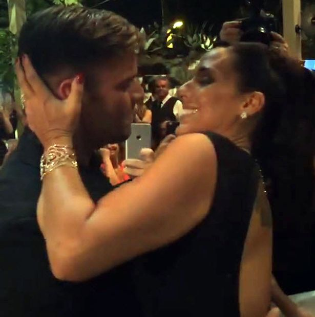 Ricky Martin and Ana Diniz who paid $90,000 for kiss