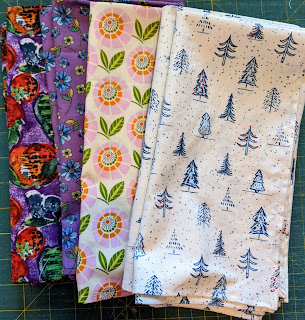Woven cotton prints with purple or white backgrounds