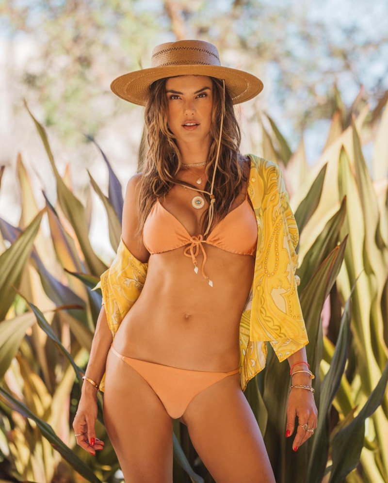 Accessorized with a straw hat, Alessandra Ambrosio poses in Gal Floripa Ethereal bikini set.