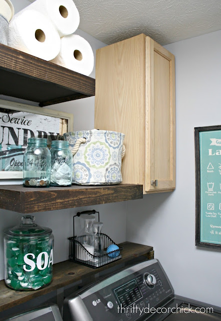 Floating shelves in laundry room