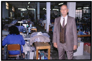 Libero Grassi pictured in his factory in Palermo