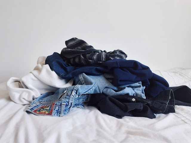 aesthetic clothing on bed, decluttering