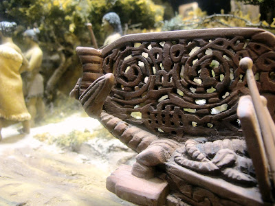 Detail of the carving on a one-twelfth-scale diorama of a maori waka (war canoe).