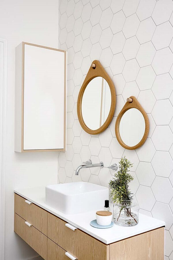 The round bathroom mirror with wooden frame