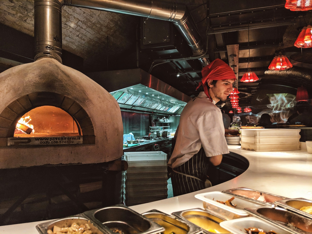 The kitchen is completely open and a wood-fired oven acts as the centre piece of the restaurant.